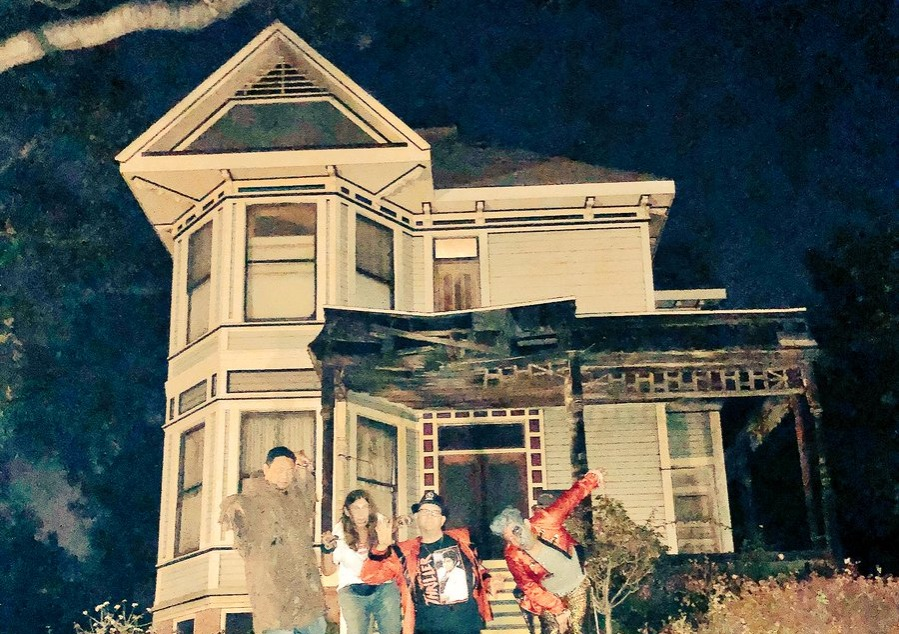 Halloween zombies swarming the Thriller house