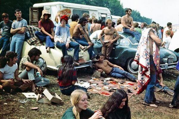 people gathered around their cars at woodstock 1969