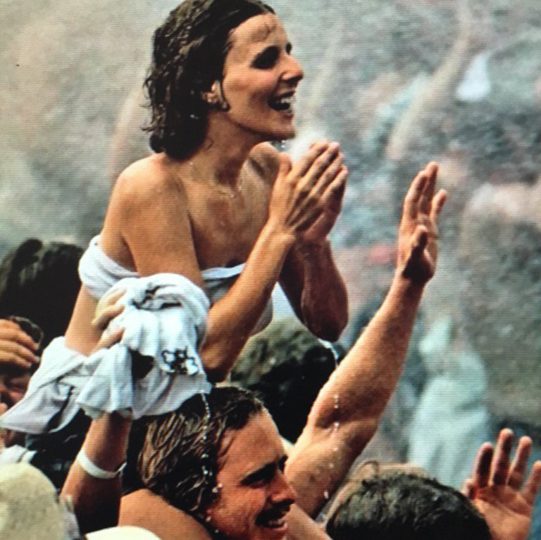 people in the rain at woodstock in 1969