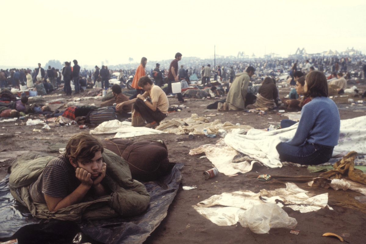 People in the messy field at the Woodstock Music Festival, New York, US, August 1969.