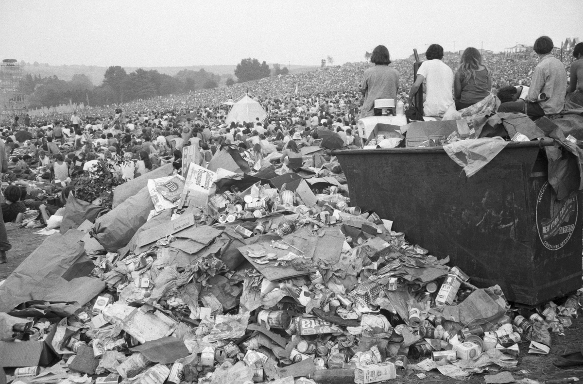 Refuse overflows a trash bin as the Aquarian Rock Explosion ends early August 18. Estimates of up to half a million people have been made to describe the mobs who descended on a farm site here for three days of rock music, love, drugs, rain and mud.