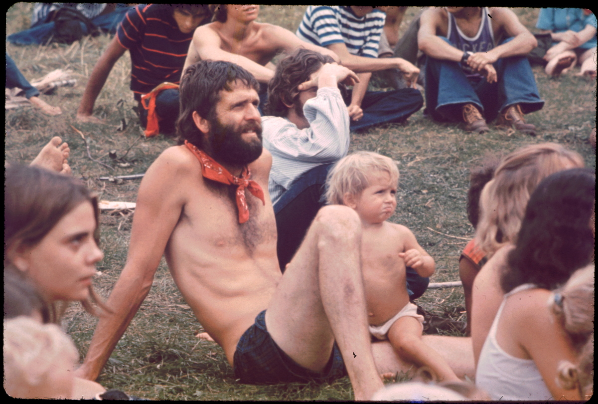 Ken Babbs, one of the Merry Pranksters, in the Free Stage audience watching the puppet show at the Woodstock music festival, August 1969.