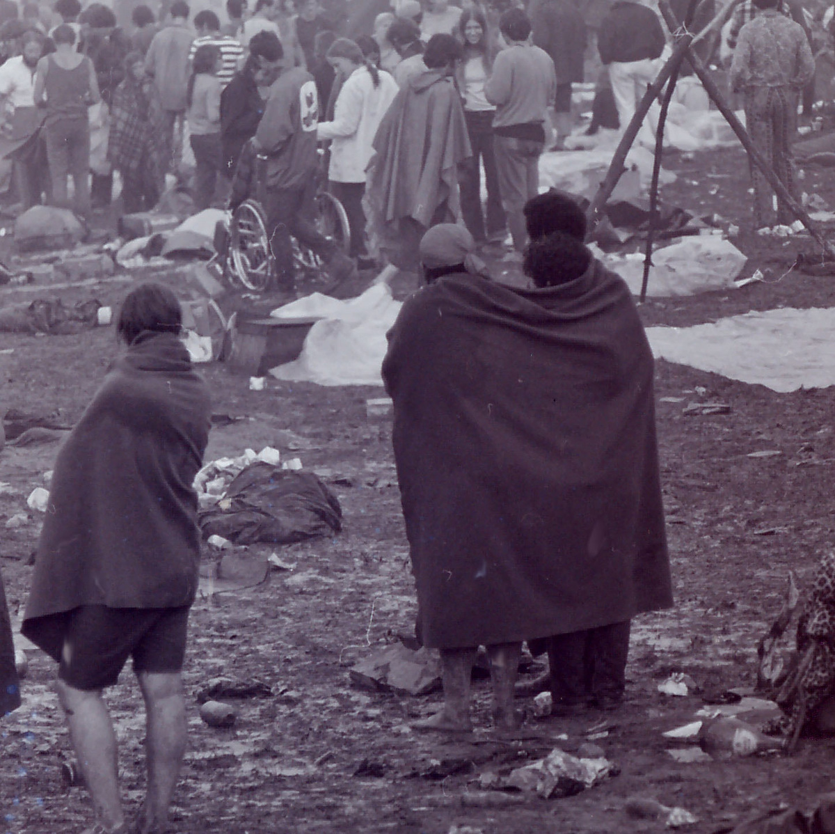people enjoying woodstock in the rain and mud