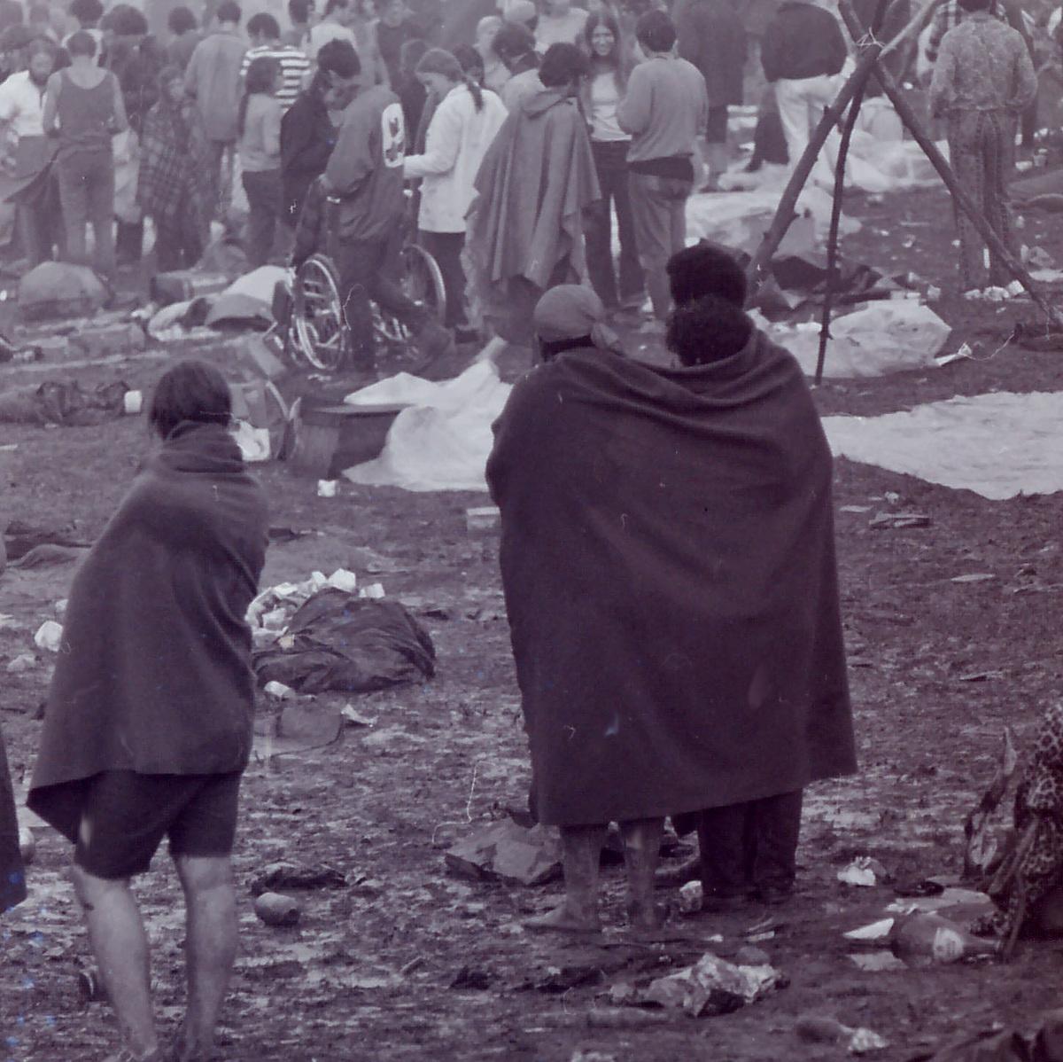 people enjoying woodstock in the rain and mud