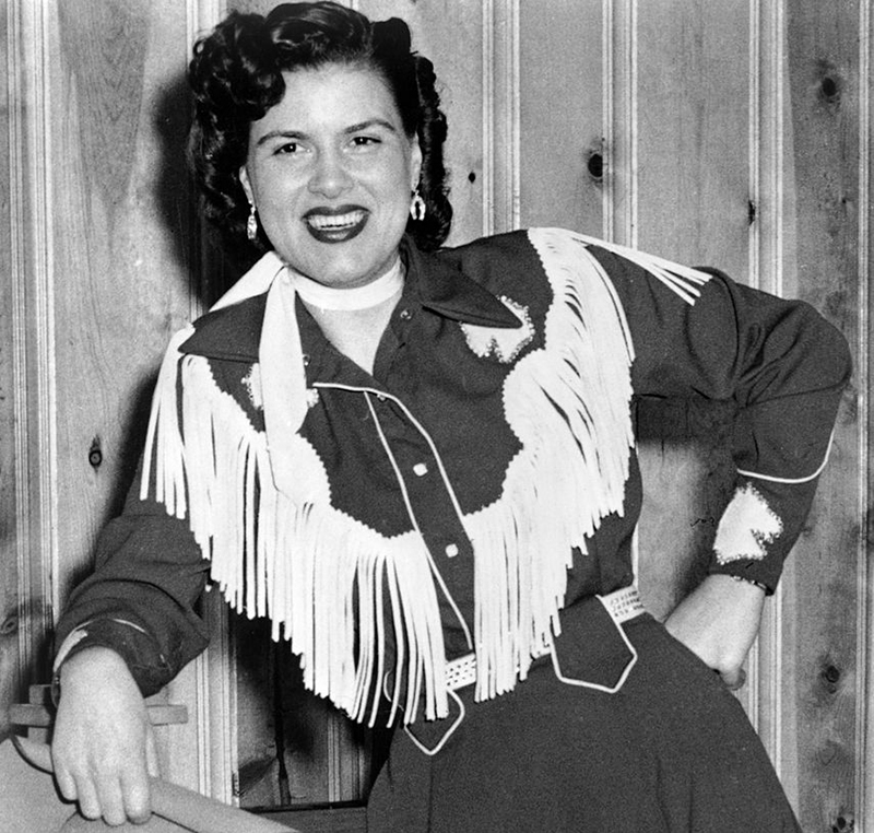 Patsy smiles while dressed like a cowgirl