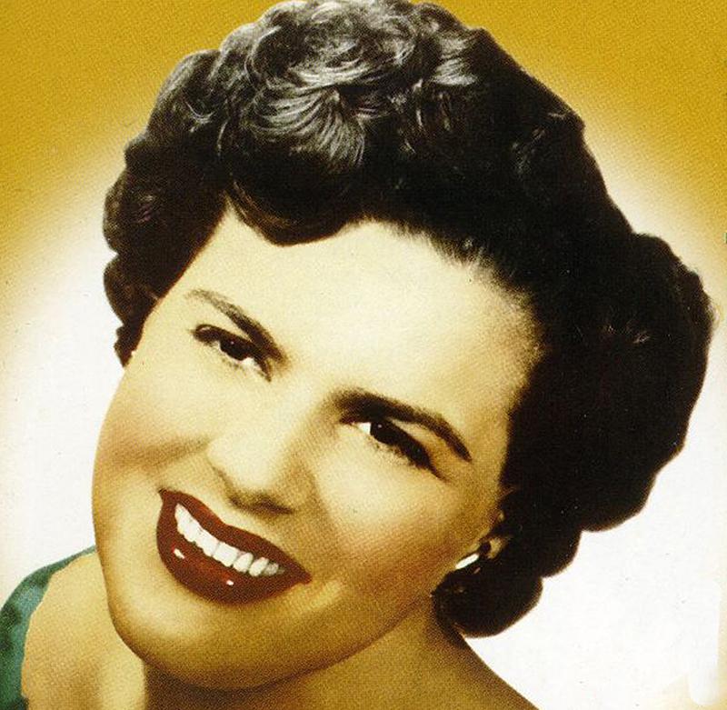 A headshot shows Patsy smiling endearingly