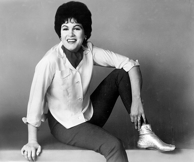 Patsy is photographed with her leg propped up and one arm resting on one knee