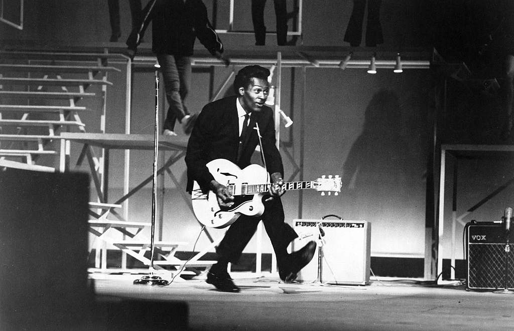 Chuck Berry crouching down