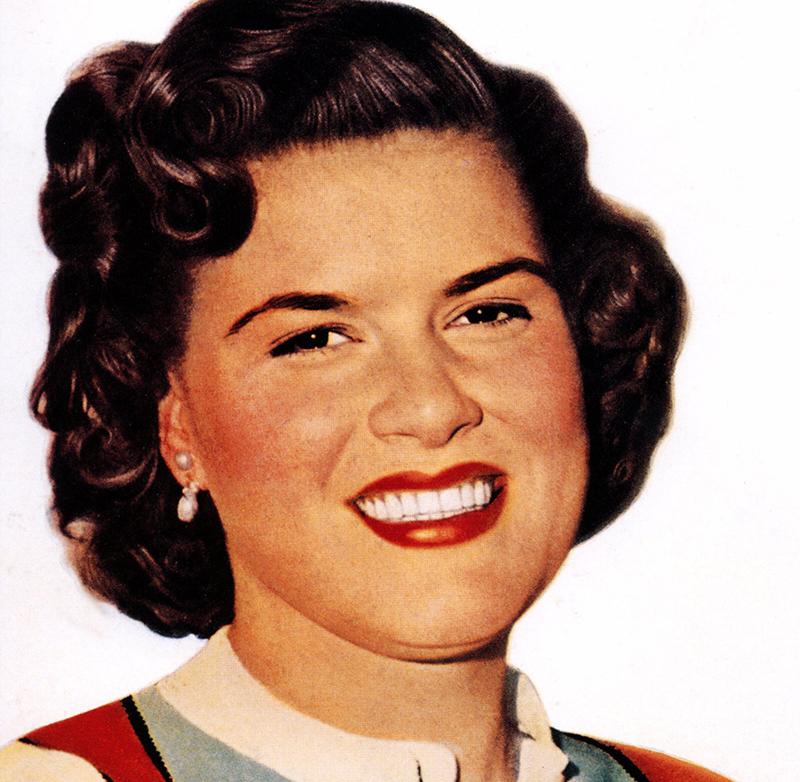 Patsy smiles at the camera