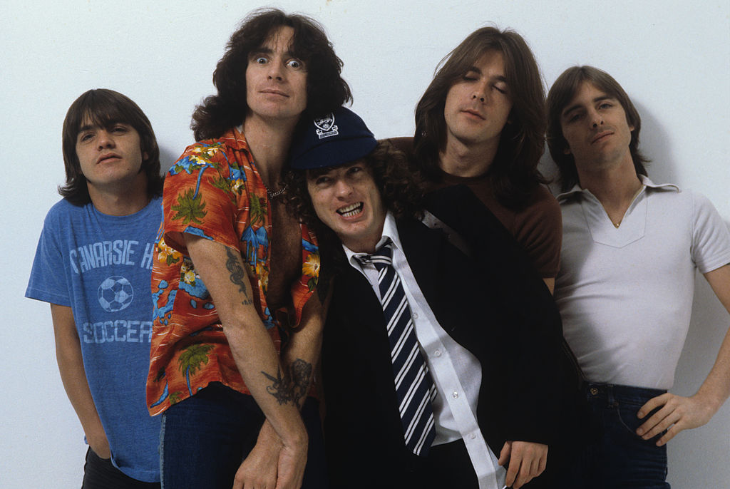 ac/dc band members posing for a photoshoot