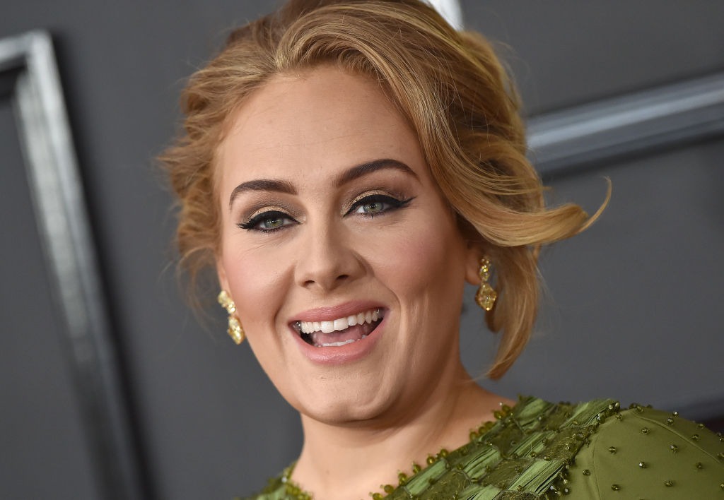 adele on the red carpet for the grammy awards in a green dress