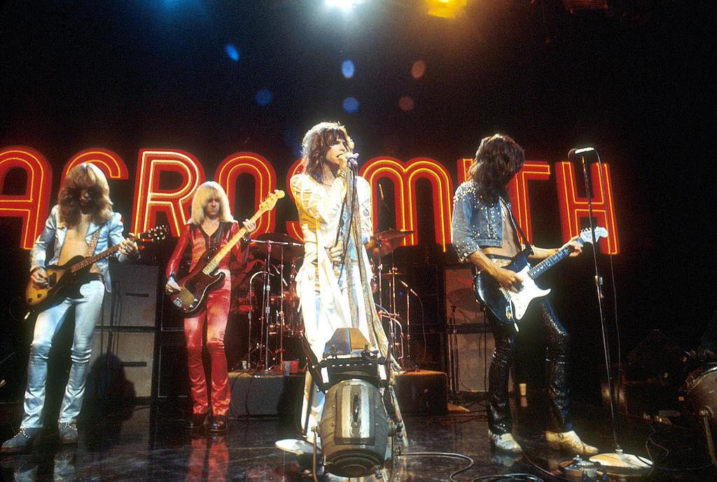 Aerosmith performing on