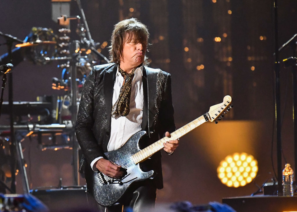 Now, Richie Sambora Is Trying To Rock His Guitar And A Mullet
