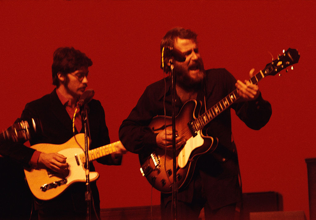 Robbie Robertson and Levon Helm of The Band performing in concert
