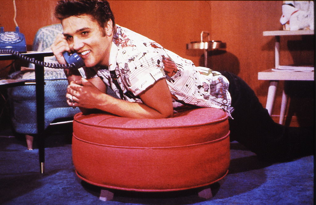 a young elvis on the phone