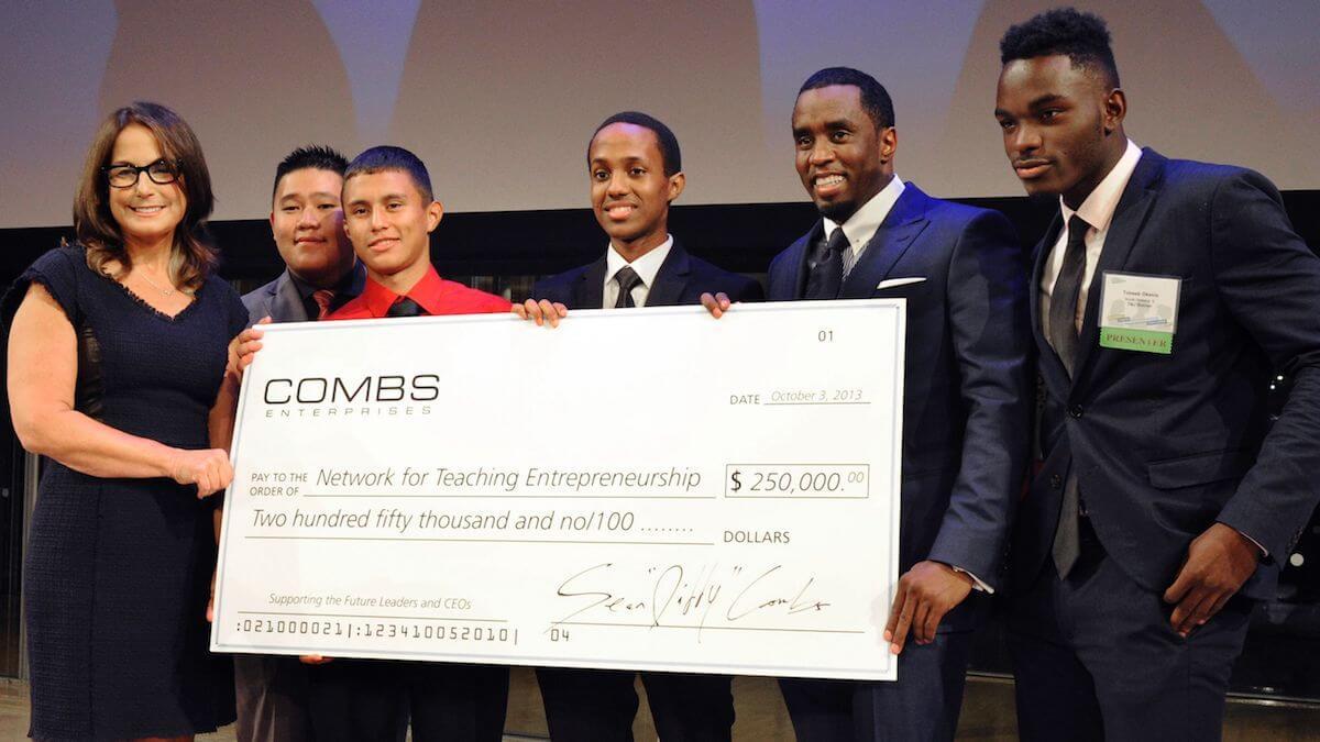 100413-lifestyle-diddy-check-donates-youth-entrepreneurship-organization.jpg